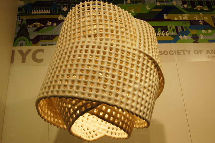 "It took several years for Brooklyn designer <a href=""http://scottdanieldesign.com/index2.php#/home/"">Scott Strickstein</a> to perfect the process of creating his ceramic light fixtures, called C Mesh. This one weighs about forty lbs."