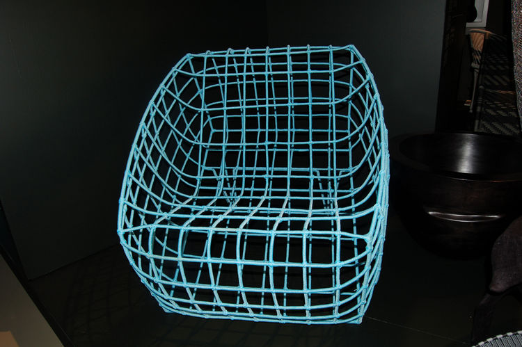 "At <a href=""http://www.amaridianusa.com/"">Amaridian</a>'s booth, a turquoise nylon-cord chair created by Malian designer Cheick Diallo was on display."