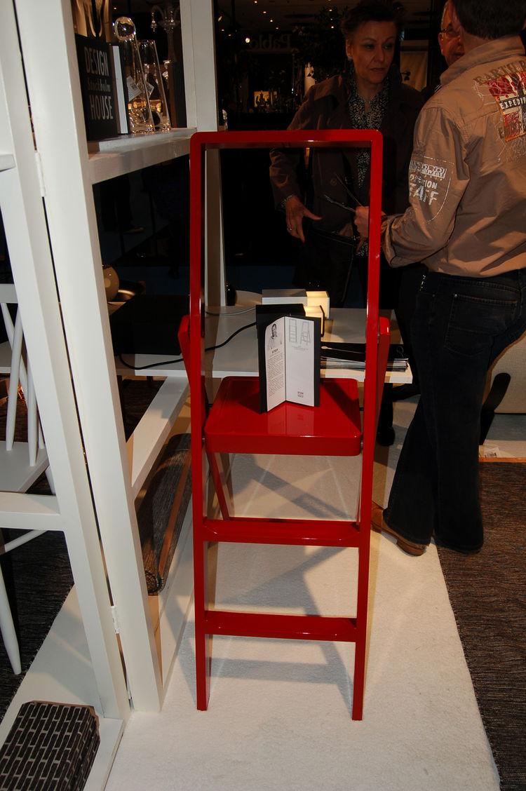 "At <a href=""http://www.designhousestockholm.com/"">Design House Stockholm</a>'s booth, industrial designer Karl Malmvall's Step ladder—which folds up into an impressively diminutive two inches—was displayed in glossy black, white and red."
