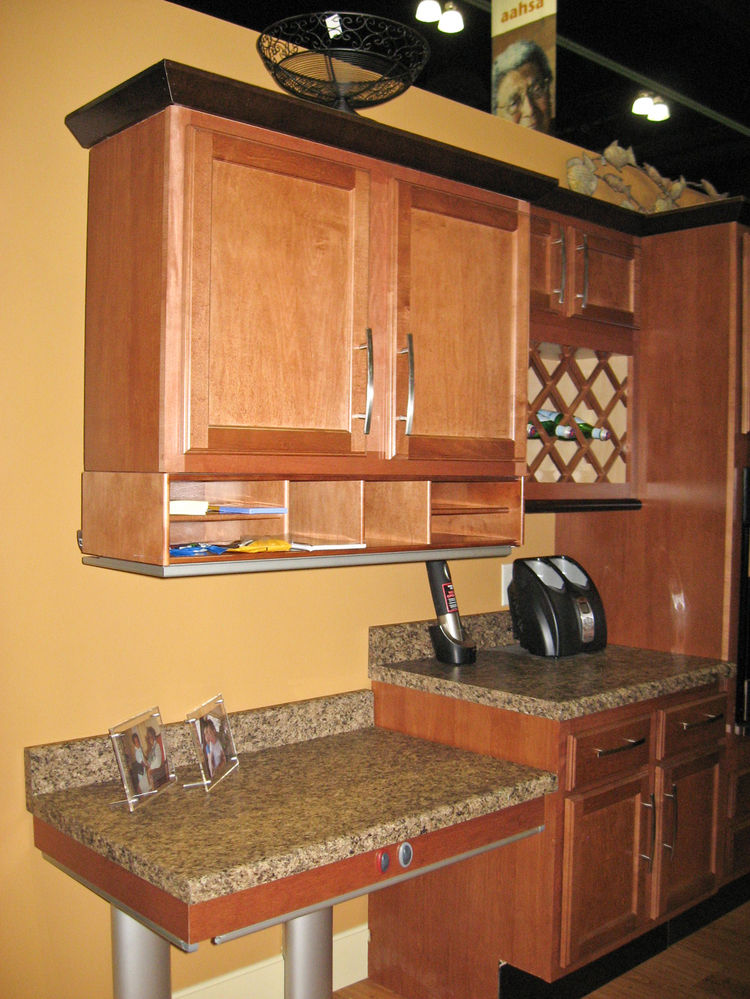 Pressalit Care electric lifts, distributed by New England Medical Systems, adjust countertops from 24 inches to 38 inches above the finished floor to accommodate people of different heights and capabilities in the same household. Wall cabinets also can be