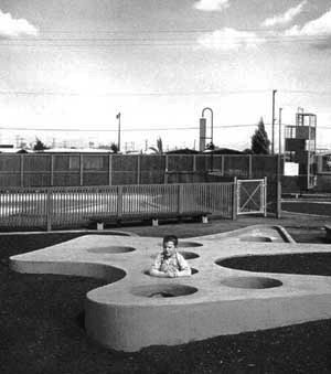 "While sculptors focused on designing better playground ""parts,"" landscape architects began to emphasize the complete play landscape: a playscape. Robert Royston's California parks included pedal car freeways and ""gopher holes."" The freeways are gone, but"