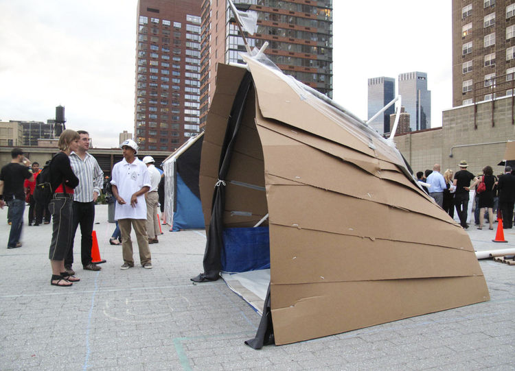 "Self-replicating nanobots were the foe of <a href=""http://www.turnerconstruction.com/"">Turner Construction</a>, who designed a central tension ellipsoid ring structure as the basic connection between roof and vertical support, complete with cardboard scal"