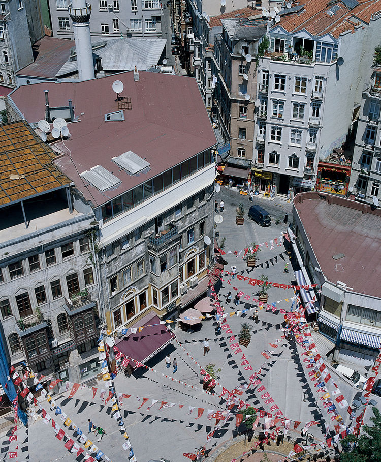 Looking down from Galata Tower onto Galata Square, festooned with flags and home to a number of cafés and street vendors.