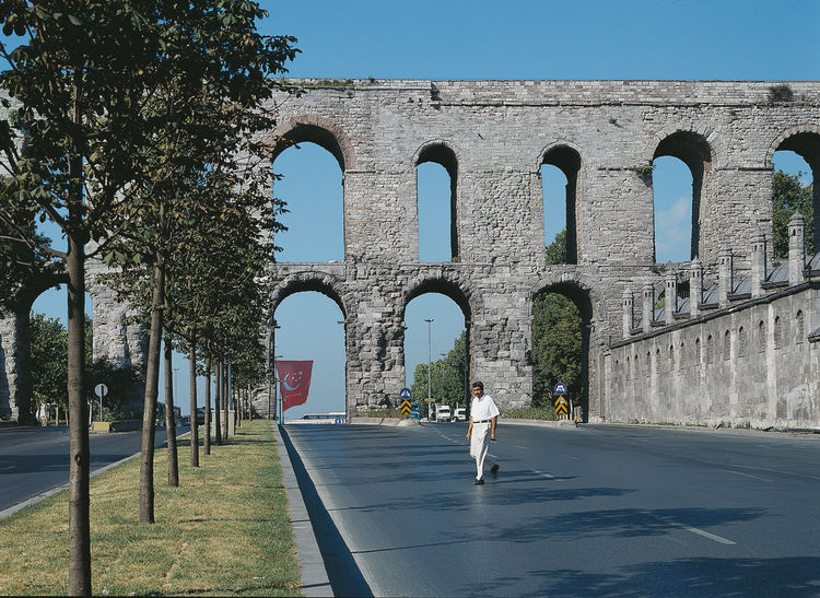 The arches of the Valens Aqueduct, completed in 368, span a busy avenue, fusing the ancient with the modern—a common juxtaposition in Istanbul.