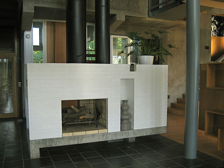 The hearth is central, and like the rest of the house, reassuring in its classism, in both proportion and assembly. While in a way austere, the richness of material keeps the house from feeling cold or operational. Still, it has to be understood as an exe