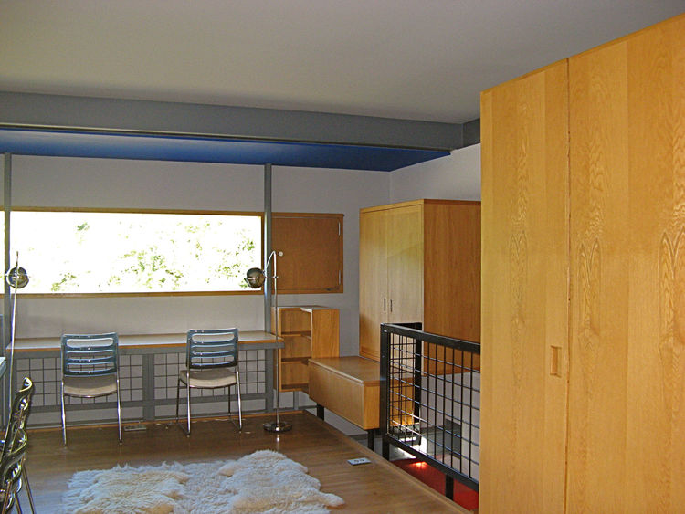 "A view of one of the boys' bedroom shows how the furniture was built into the wall and the relationship of walls to the floor, making clear, as Guyon has described, that this is really ""an experiment masquerading as a house."" As is indicative of a pure Mo"