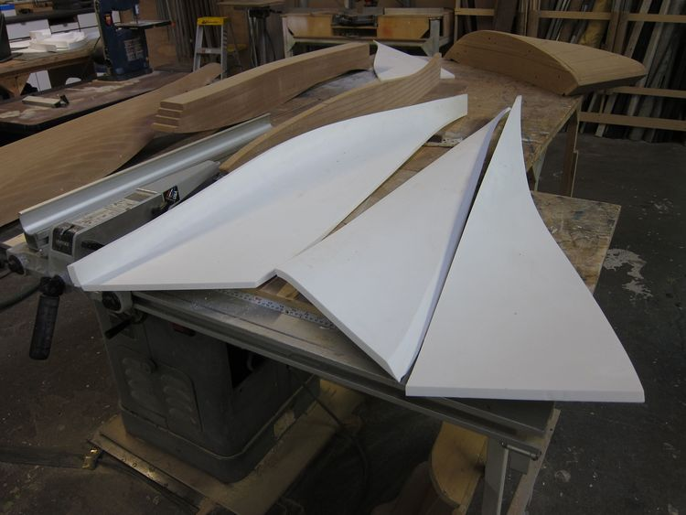 Here are the filled and vacuum-formed Corian parts of the unit, laid out in Associated Fabrication's workshop prior to assembly. You can spot the MDF molds visible in the background.