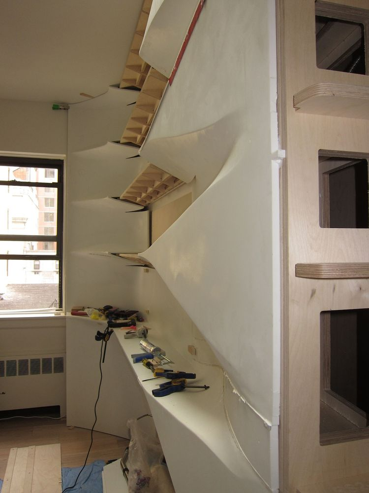 Then they glued the partially assembled Corian shelving unit over the plywood substructure.