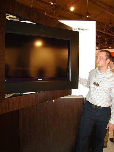 "Up-and-comer Kevin Wiggers introduced a beautifully distinguished furniture piece, which disguised an ""unsightly"" flat screen television. Calling it a ""tv console"" would be a disservice. This luxuriously appointed piece features hardwood veneer inlays and"