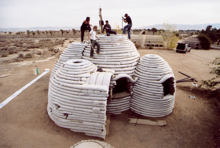 "A nearly complete ""superadobe"" home showcases its sandbag bones."