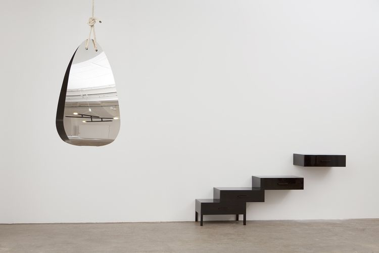 """Fernando and Humberto Campana's hanging """"Fata Morgana"""" mirror (on left) and Pierre Charpin's Monolithe (on right)."""