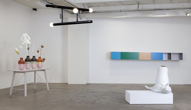 """An installation view of the """"Materials for Consideration"""" show, in the spare white gallery space. Most pieces are available in a limited edition of eight, plus two artists' proofs and two prototypes."""