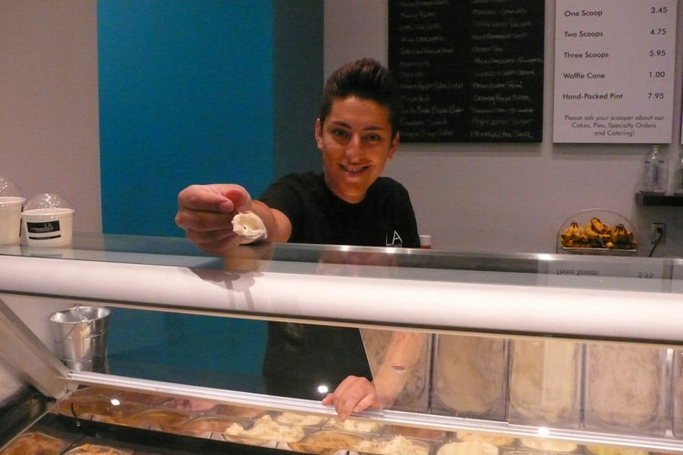 Daniel offers a sample of Bourbon flavor ice cream, on an eco-friendly stainless-steel testing spoon.