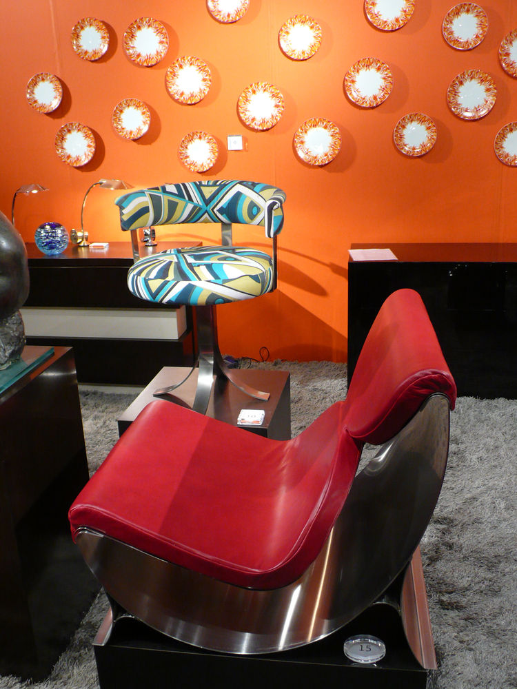 "A steel-and-leather chair by French designer Maria Pergay (born in 1930), one of only eight, before a 1970 steel chair covered in vintage Pucci fabric. From <A HREF=""http://www.dragonetteltd.com/search.php"">Dragonette</A>."