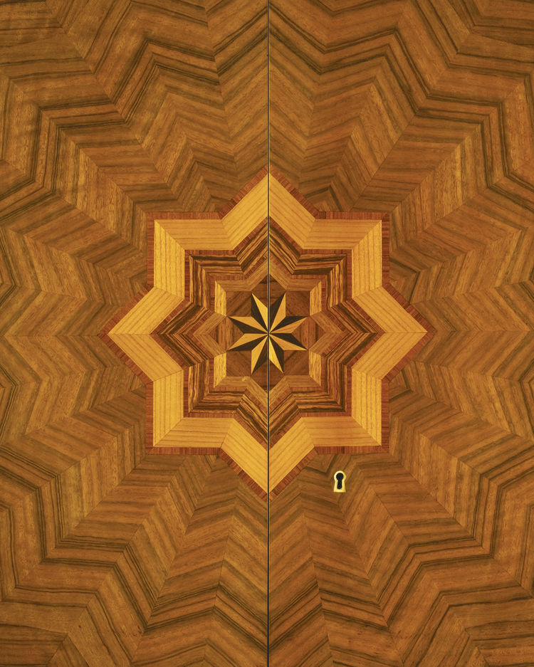 "A detail of the secretary's starburst inlay. Photo courtesy <a href=""http://www.szalonantiques.com/"">Szalon</a>."