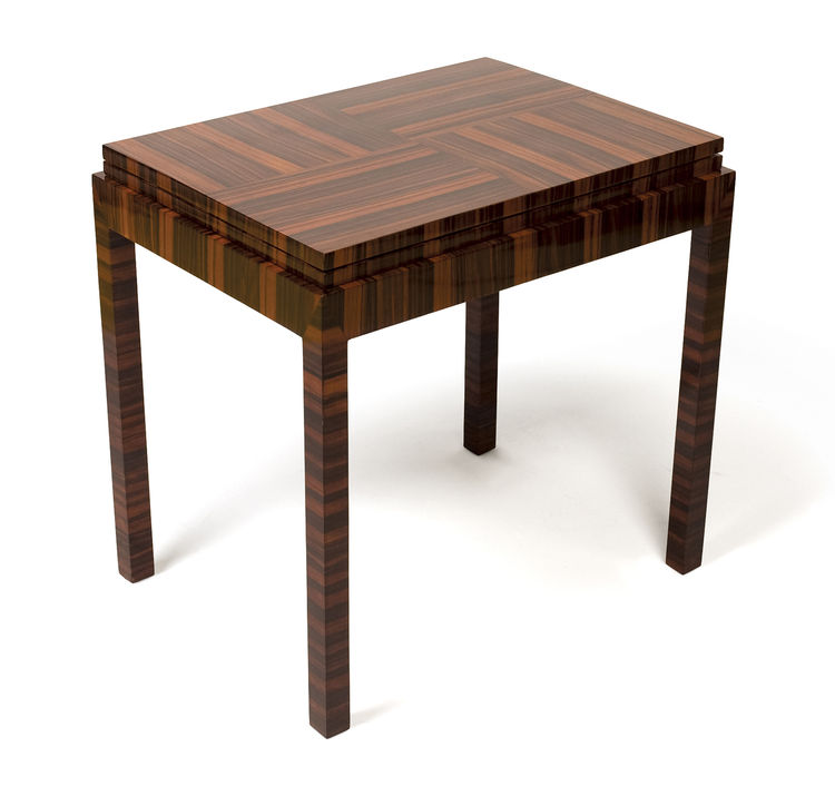 "A circa 1930s zebrawood table, which folds out to double in size with a white-linoleum surface. Photo courtesy <a href=""http://www.szalonantiques.com/"">Szalon</a>."