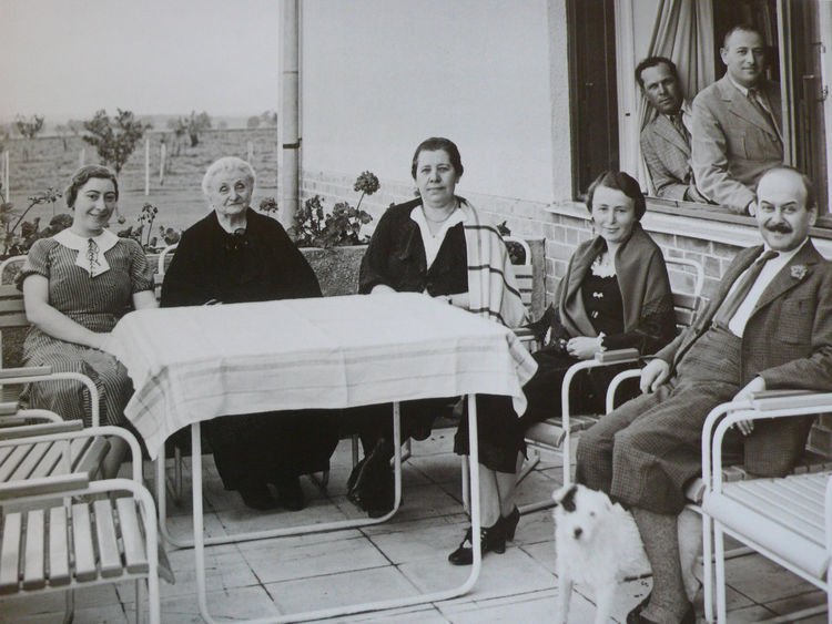 "Kozma, at right, with clients at the home he designed for them in the Hungarian village of Pókaszepetk–Taszilópusztai in 1935. Subjected to new ""Jewish laws,"" the family was forced to give up their home in 1947 and was relocated to Budapest. After the war"