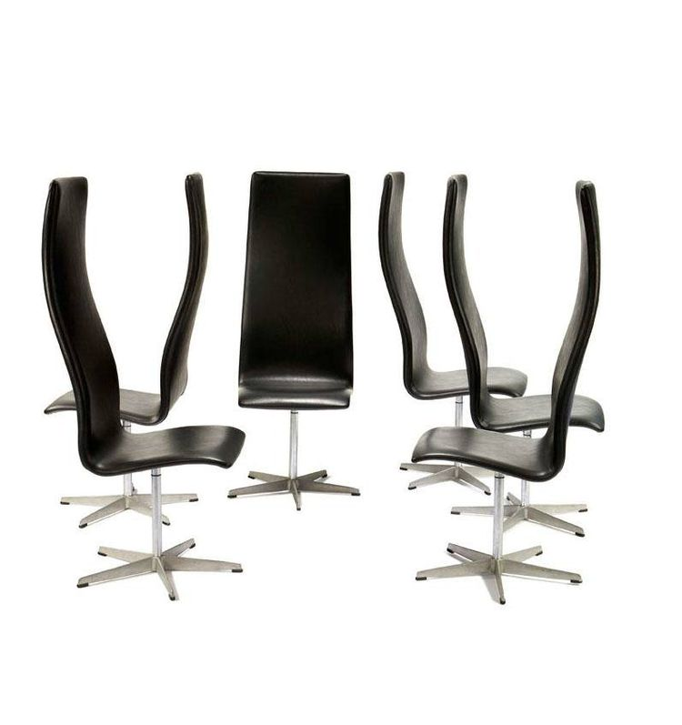 The high-backed, steel-and-leather Oxford chair by Arne Jacobsen was originally designed around 1965 for the dining halls at St. Catherine's College in Oxford, specifically for the long tables where the professors had their meals, and possibly to emphasiz