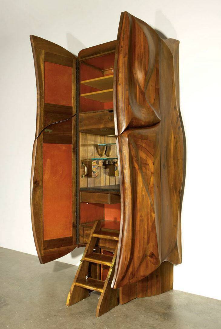 Furniture maker Philip Lloyd Powell—who opened a shop in New Hope, Pennsylvania, around the same time George Nakashima began work there—custom-made this 107.5-inch-tall bar cabinet in 1967 of walnut, slate, velvet, glass and found objects. It was discover