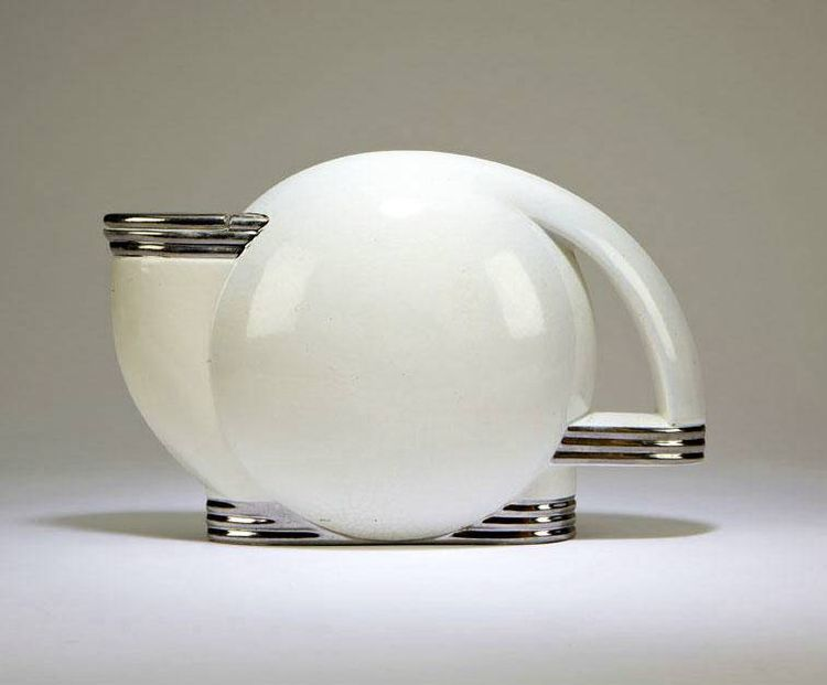 """A teapot designed in 1938 by Paul Schreckengost fits the lines of its decade impeccably, and typically brings tens of thousands when it comes up at auction (Loughrey notes that one in worse shape recently sold for nearly $50,000). This one, signed """"Paul S"""