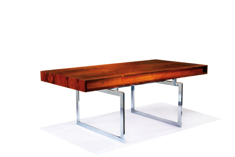 "A rosewood-and-steel desk designed in 1960 by Danish architect and designer Bodil Kjaer. She referred to her furniture designs, commissioned for buildings by Paul Rudolph and Marcel Breuer, as ""elements of architecture."" This model, number 901, was manufa"