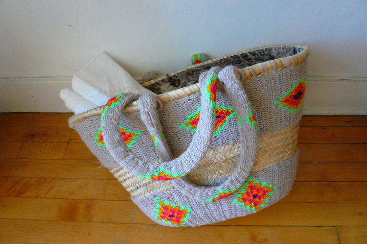 "Woven tote from Morocco, $295. ""This En Shalla Moroccan woven tote basket by a London-based husband and wife design team is just another great example of how European sensibilities can be combined with traditional regional craft to produce a new gestalt."""