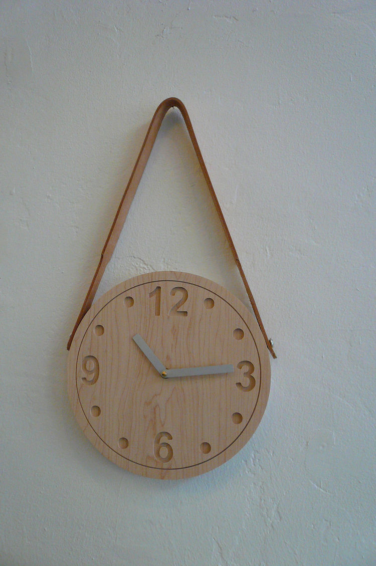 "Wooden clock with leather strap by Brooklyn-based Stanley Ruiz, $225. ""I first saw this clock when it was a prototype. I loved it then and am thrilled to finally have it for sale. Stanley really knows how to balance modern organic design with a utilitaria"