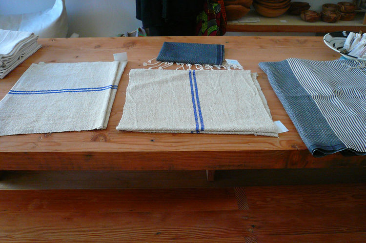 "Vintage grain-sack placemats from Transylvania, $20 each. ""The interesting thing about these hand-woven linen, cotton, and hemp recycled grain-sack placemats is the stripe. Each farmer's name was indicated by the color of their stripe, so that when they w"