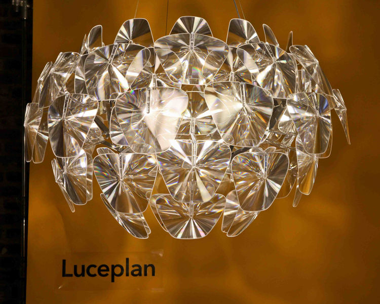 Incredibly light but painstaking to assemble, Luceplan's Hope light proved to be worth every second, illuminating the room, and drawing many oohs and aahs as guests stared into the reflective plastic. A series of thin polycarbonate Fresnel lenses, created