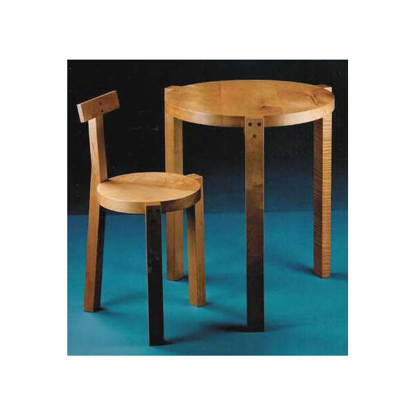 Bo Bardi crafted her Giraffe table and chair from various hardwoods with contrasting dowels.