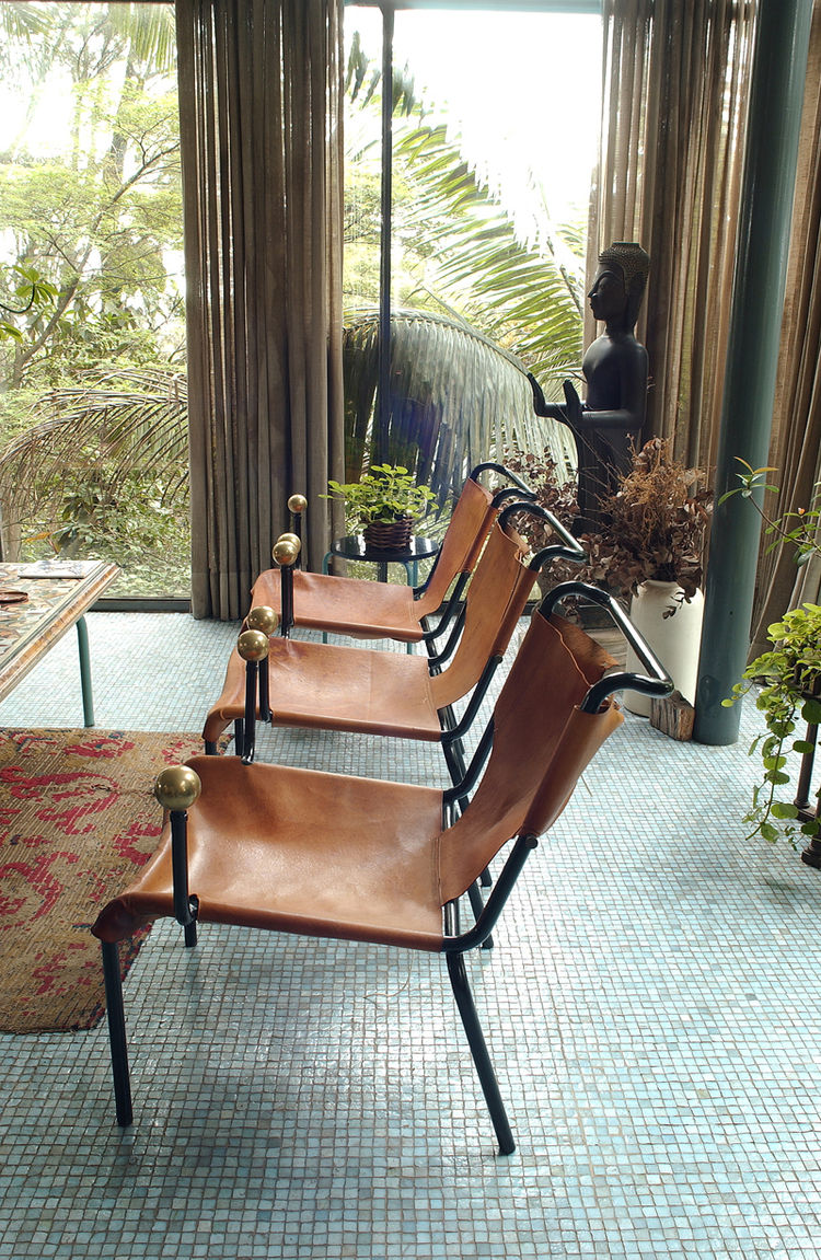 """The leather sling and ball motif of the dining chairs were repeated in other Bo Bardi designs. Photo courtesy <a href=""""http://espasso.com/"""">Espasso</a>."""