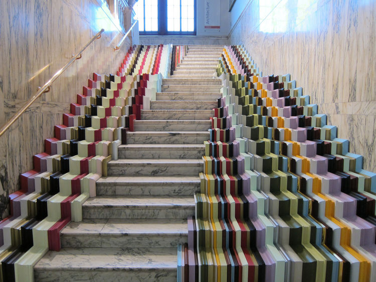"Stuart Haygarth is well known for his masterful repurposing of <a href=""http://www.dwell.com/articles/design-junkie-profile.html"">detritus</a>, and for his installation at the V&A has transformed a banal staircase into an explosion of color using over 600"