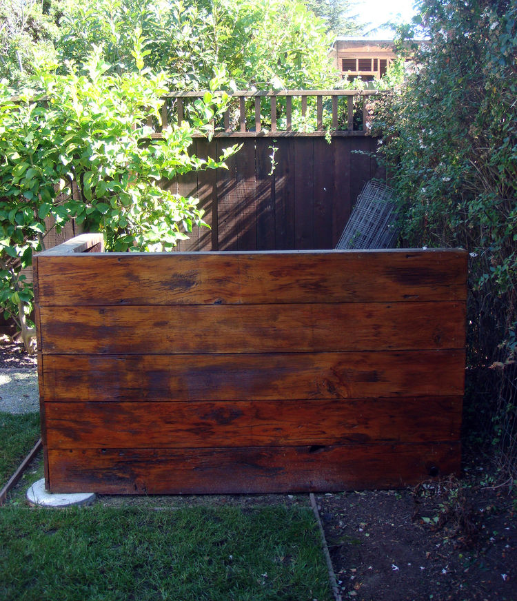 """Composting on-site also counts toward the GreenPoint rating. Here, the bin is obscured by a small enclosure made out of wood reclaimed from the original structure. For more info on Built it Green and the GreenPoint rating system, please visit <a href=""""htt"""