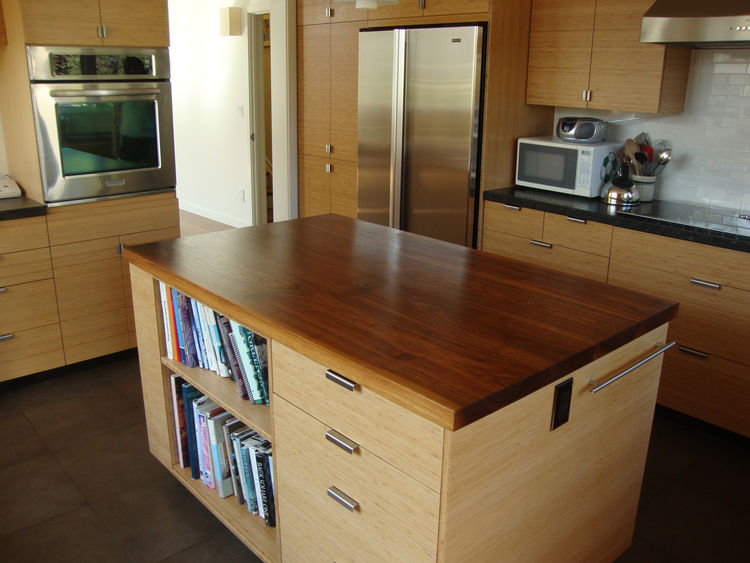 """""""Working with GreenPoint's system and the rater helped us learn a lot about sustainable design and if I had to do it again, I would,"""" says Ian.<br /><br />The spacious eat-in kitchen features bamboo cabinetry and walnut work surfaces. The white subway til"""