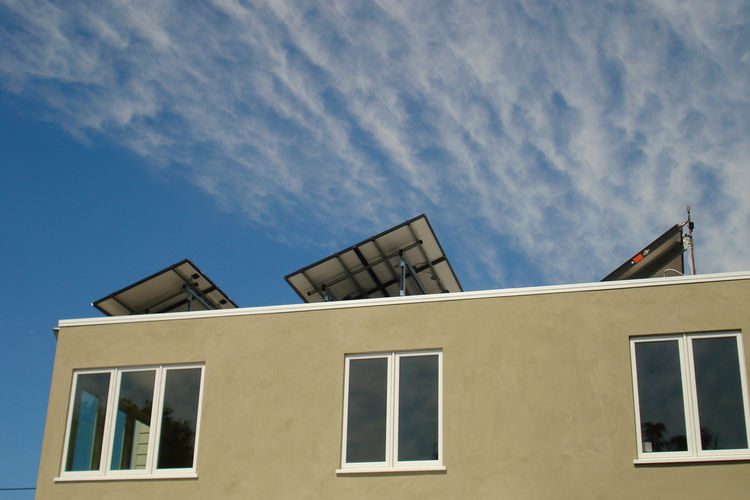"""One of the main additions to the home was the rooftop solar hot water and 2.1 kW energy system, shown here from the rear of the house. The system is by <a href=""""http://www.heliodyne.com/"""">Heliodyne</a>."""