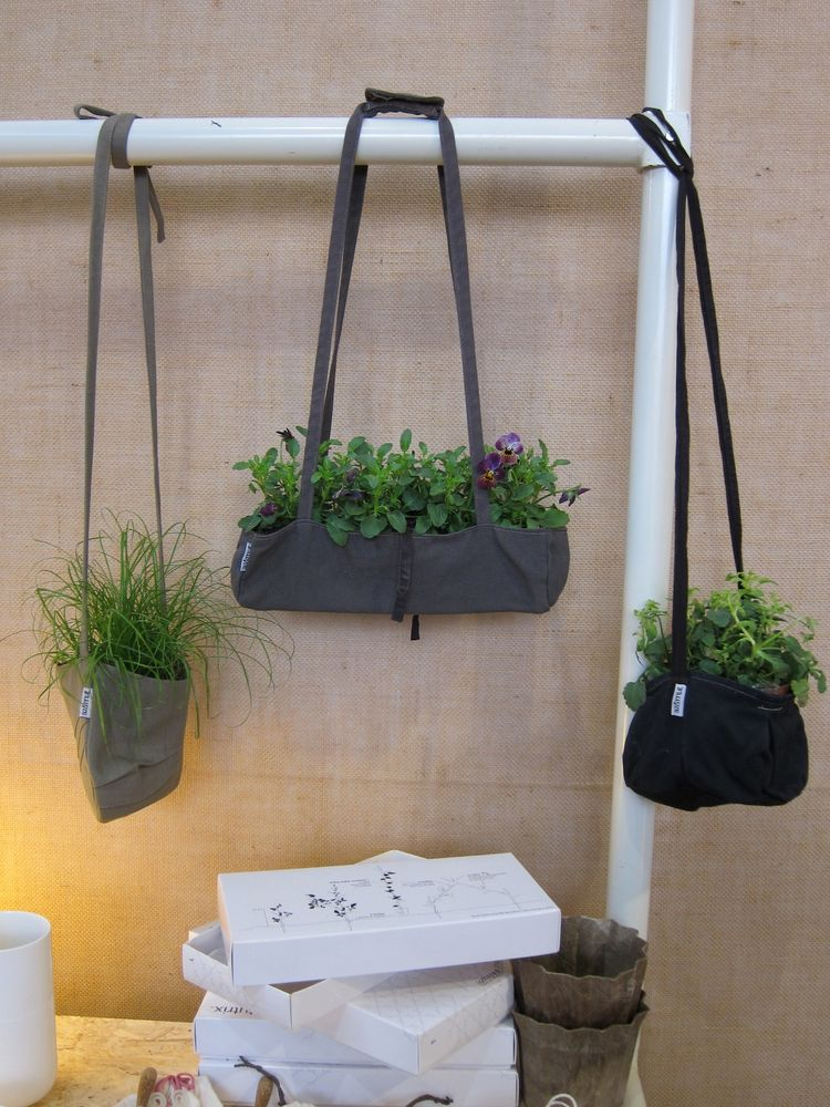 Indoor 'urban gardening' quickly revealed itself as a trend this year. I've culled some examples for you. These cute danglers are 'BacSacs.' The company also makes larger modular grids that sit on the ground.