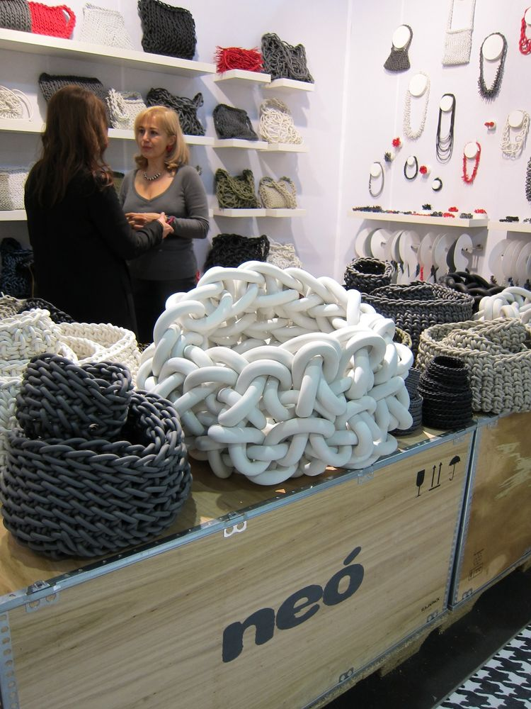 Moving along...These woven neoprene baskets by Neó have a wonderful tactile quality. Everyone who walked by gave them a squeeze.