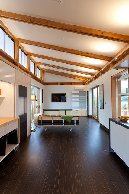 "The interior spaces are finished with a combination of southern yellow pine and laminated veneered lumber, which helps reduce thermal loss and also allows for more space between structural supports. The durable flooring is the <a href=""http://www.oregonlu"