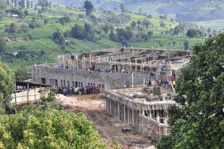 "Here, the workers (there are a total of 200, all local) are laying the foundation for the covered outdoor veranda.  According to Ebbe Strathairn, a designer who recently moved to Rwanda in the summer of 2009, ""Multiple times our on-site guy has been asked"