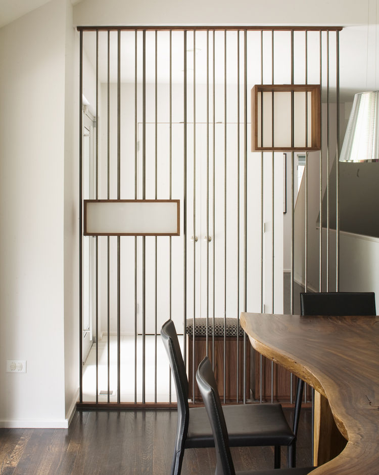 "One of our favorite MAKE-made details in the Hufft catalog is this screen in the ""Modern with a Side of Ranch"" house. Made of walnut plywood, steel rods and 3form, the the shape and materials are echoed later in the dining room credenza."
