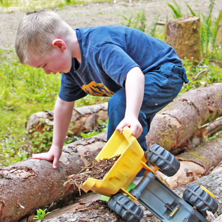 Charlie, our youngest sets up his own construction site on the property and transfers some wood chips with the help of histruck. He's practically grown up on the property and the transition to his future playground has been seamless.