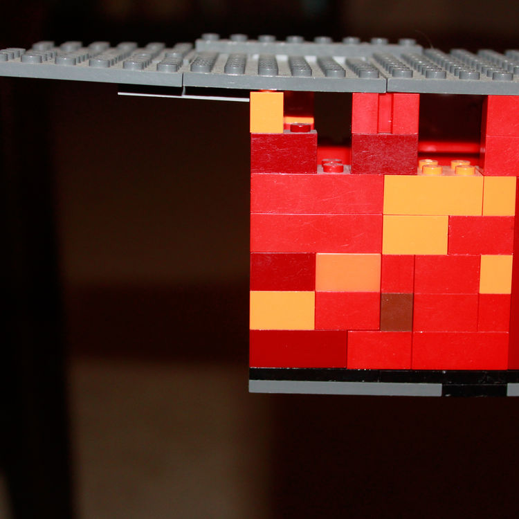 How do you represent oxidizing raw steel with Legos? A multicolored red, orange, and yellow mix helps represent the outer skin ofour future home. The kids inspired me to create a rough model of our house based on our initial schematic plans. Here,a peek