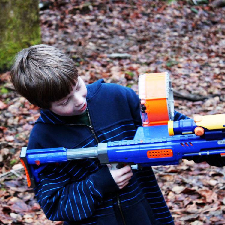 Henry takes aim with his Nerf gun while visiting the property. The forested site has provided a perfect backdrop for epic Nerf warsand other makeshift battles. The kids have gotten to know the site and become comfortable in their future backyard during f