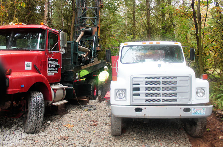 Step Two: Prepare the site for the well drilling equipment. We had to secure a clearing and grading permit for the equipment to access the well site. This involved permitting, clearing trees, and creating a new road that we'd eventually have to build anyw