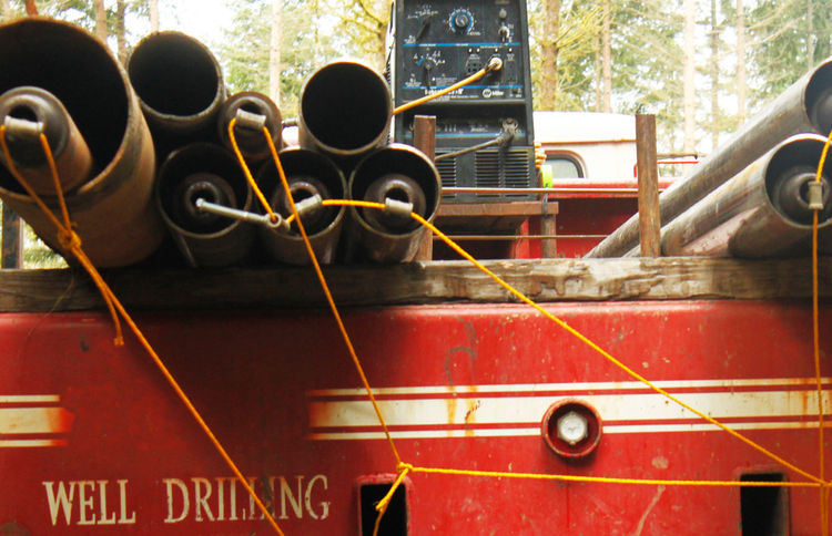 Step Six: More steel tubing. More green dollars. A closeup shot off the back of a drilling support truck shows the steel tubing that goes into the ground. The more tubes we had to use, the more money it would cost us. When you start seeing fewer of them s
