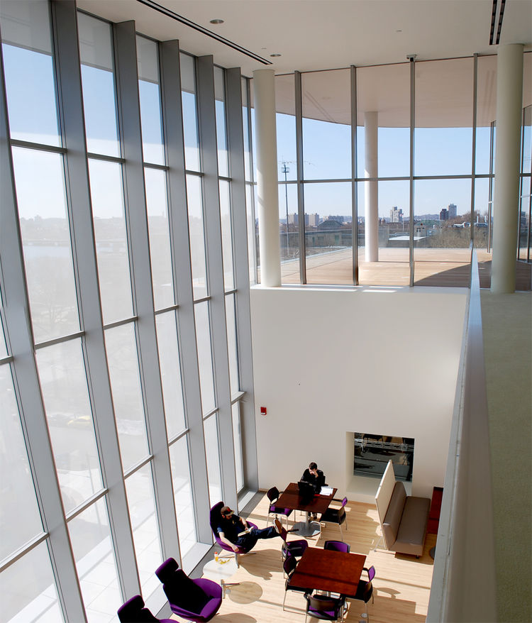 "While Maki and Associates wanted floor-to-ceiling transparency, Massachusetts energy code states that no building can have over 50% glass enclosure. This presented a problem that Maki cleverly skirted -- by utilizing 1"" circular aluminum rods spaced one i"