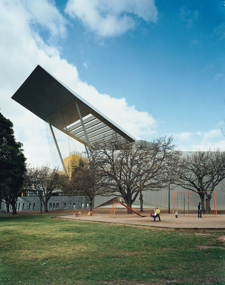 Another contemporary structure, the Melbourne Museum, is visible from the opposite side of the city.