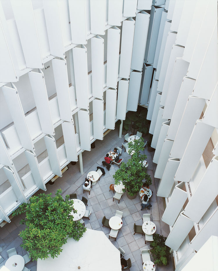 The patio café at Condesa df is framed by the hotel's unique sliding balcony shades.
