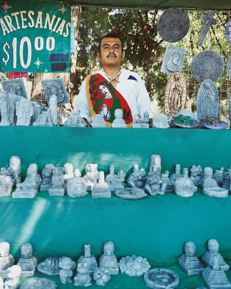 A vendor sells artisanal goods outside the Museo Nacional de Antropología.
