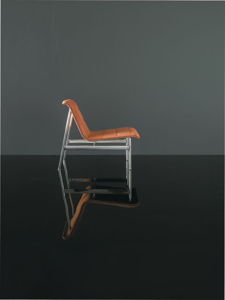 Modern leather and stainless steel chair by Charles Pollock